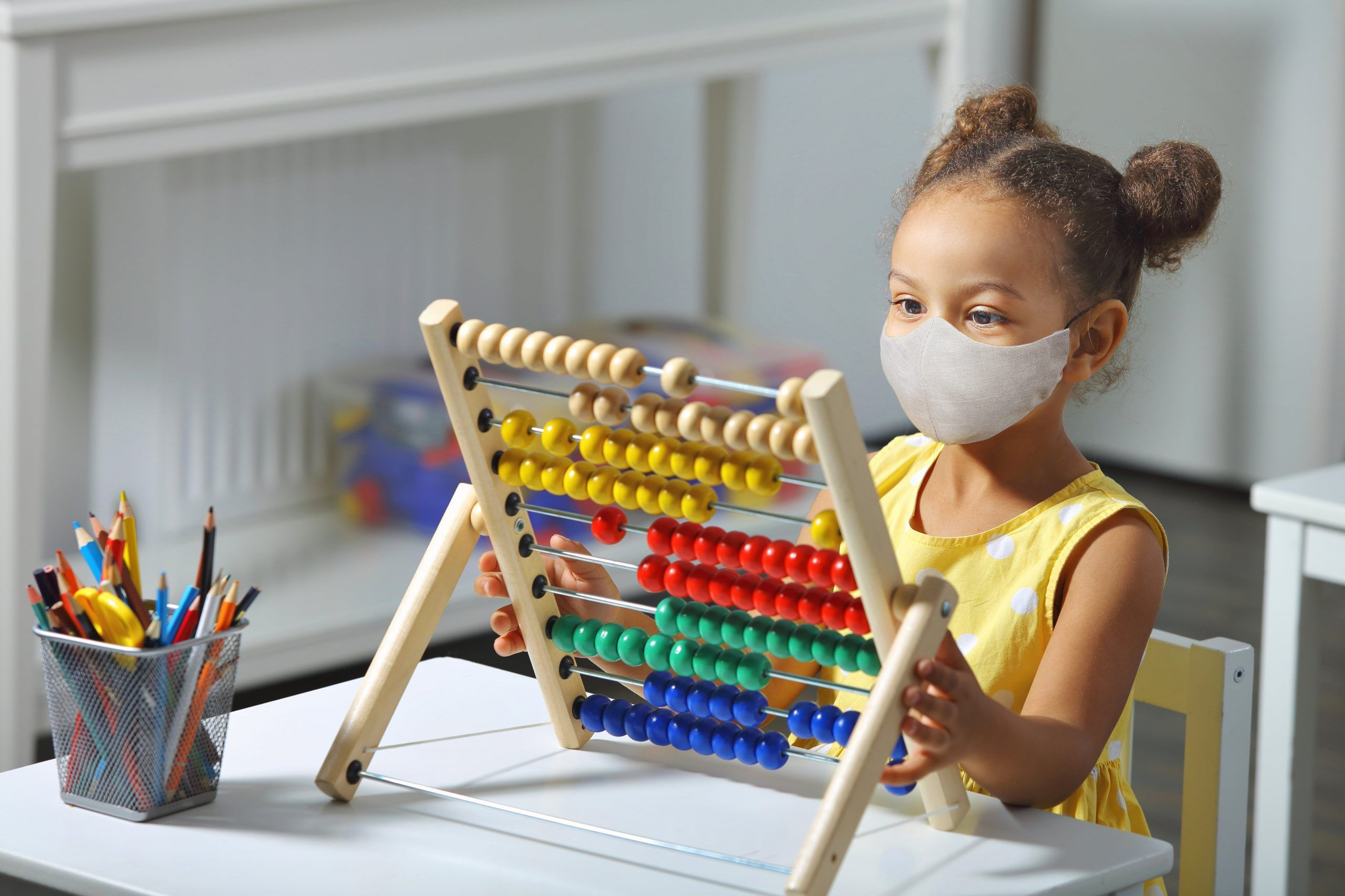 Maths Monday- Girl playing with Abacus-min