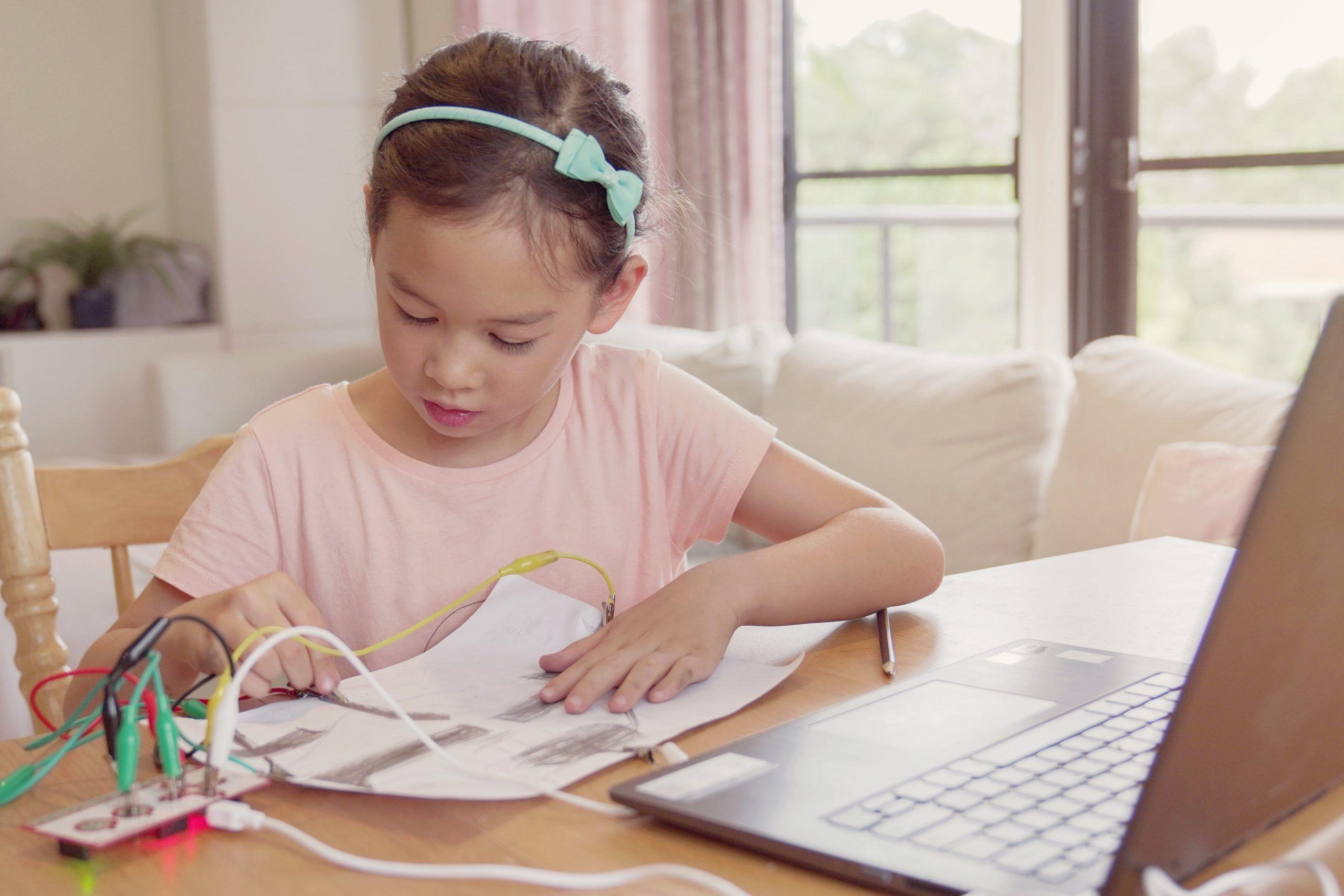 girl doing text-based coding-min